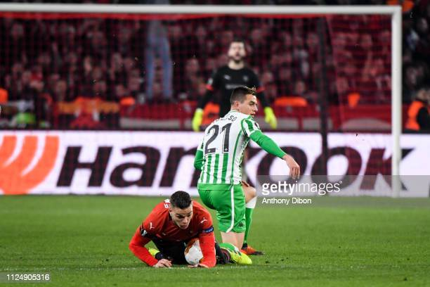 Giovani Lo Celso of Real Betis and Hatem Ben Arfa of Rennes during the UEFA Europa League Round of 32 First Leg match between Rennes and Real Betis...