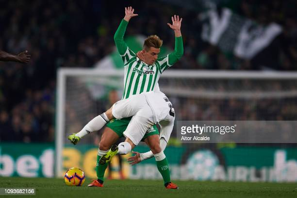 Giovani Lo Celso of Real Betis Balompie competes for the ball with Luka Modric of Real Madrid CF during the La Liga match between Real Betis Balompie...