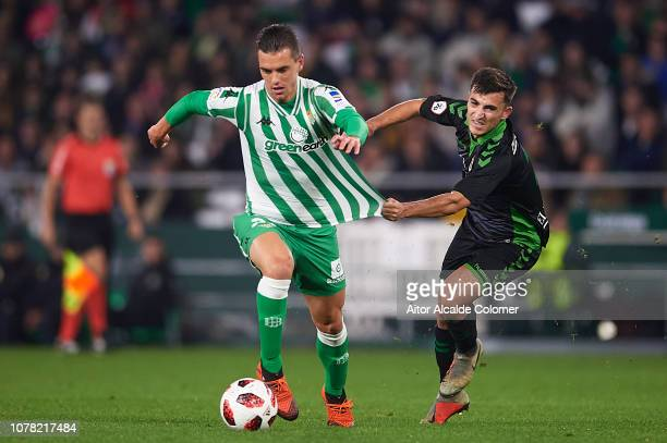 Giovani Lo Celso of Real Betis Balompie is challenged by Aitor Buñuel of Racing de Santander during the Copa del Rey match between Real Betis and...