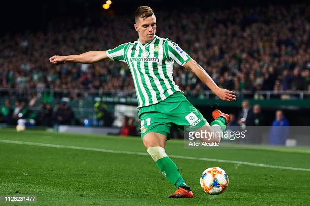 Giovani Lo Celso of Real Betis Balompie runs with the ball during the Copa del Semi Final match between Real Betis and Valencia at Estadio Benito...