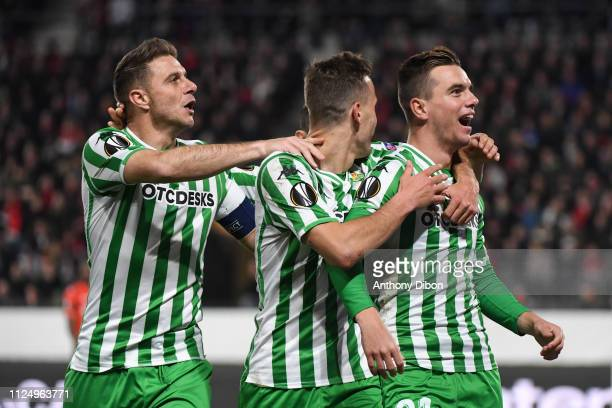 Giovani Lo Celso of Real Betis celebrates a goal with Joaquin during the UEFA Europa League Round of 32 First Leg match between Rennes and Real Betis...