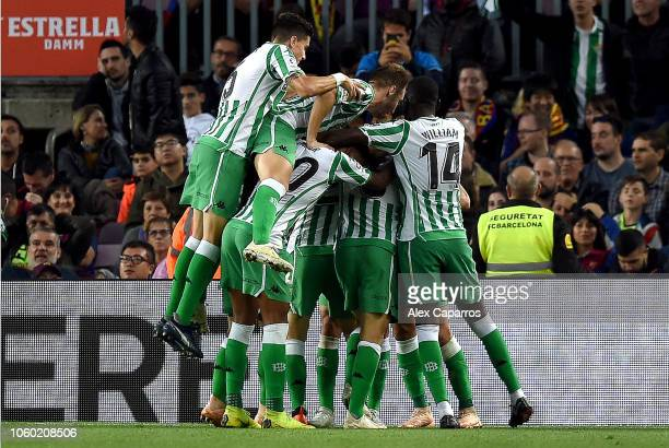 Giovani Lo Celso of Real Betis celebrates after scoring his team's third goal with his team mates during the La Liga match between FC Barcelona and...