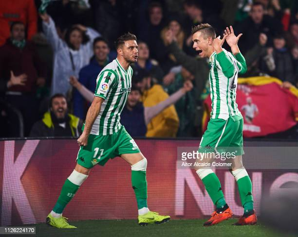 Giovani Lo Celso of Real Betis celebrates with his teammate Joaquin Sanchez of Real Betis after scoring the opening goal during the Copa del Quarter...