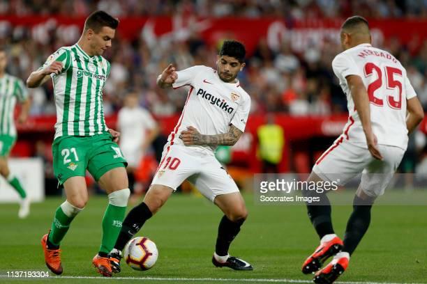 Giovani Lo Celso of Real Betis Ever Banega of Sevilla FC during the La Liga Santander match between Sevilla v Real Betis Sevilla at the Estadio Ramon...