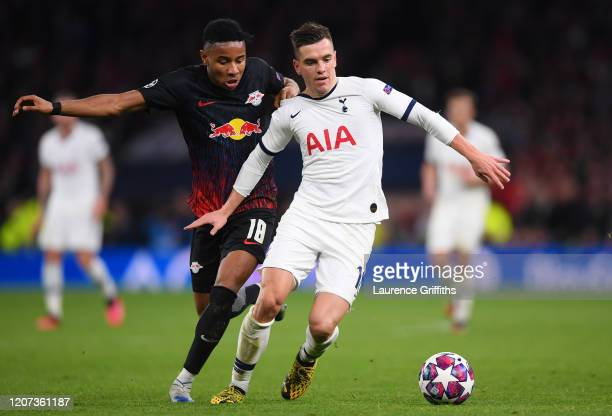 Giovani Lo Celso of Tottenham Hotspur and Christopher Nkunku of RB Leipzig during the UEFA Champions League round of 16 first leg match between...
