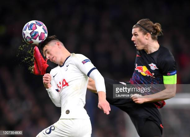 Giovani Lo Celso of Tottenham Hotspur and Marcel Sabitzer of RB Leipzig during the UEFA Champions League round of 16 first leg match between...