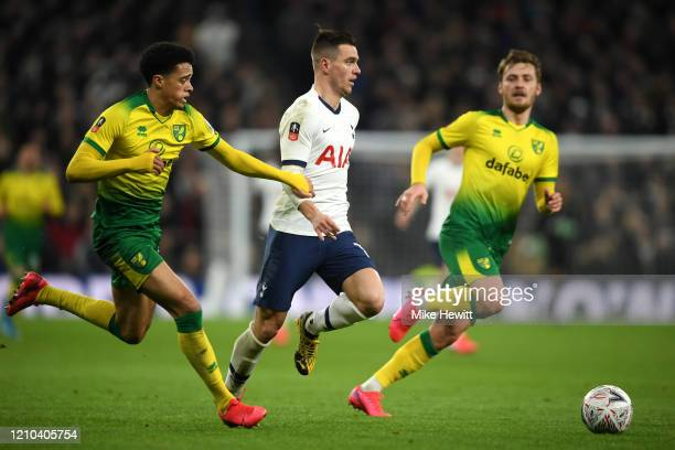 Giovani Lo Celso of Tottenham Hotspur battles for possession with Jamal Lewis of Norwich City and Tom Trybull of Norwich City during the FA Cup Fifth...