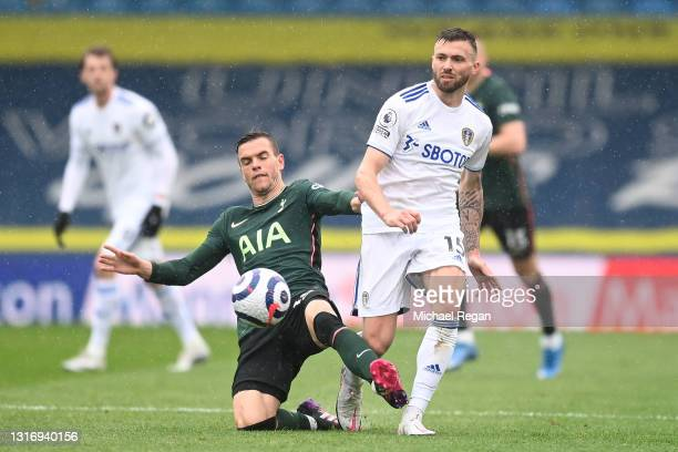 Giovani Lo Celso of Tottenham Hotspur battles for possession with Stuart Dallas of Leeds United during the Premier League match between Leeds United...