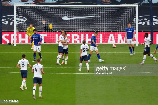 Giovani Lo Celso of Tottenham Hotspur celebrates after he scores his teams first goal past Jordan Pickford of Everton during the Premier League match...