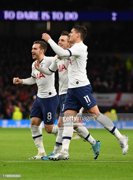 Giovani Lo Celso of Tottenham Hotspur celebrates with Harry Winks and Erik Lamela of Tottenham Hotspur after scoring his sides first goal during the...