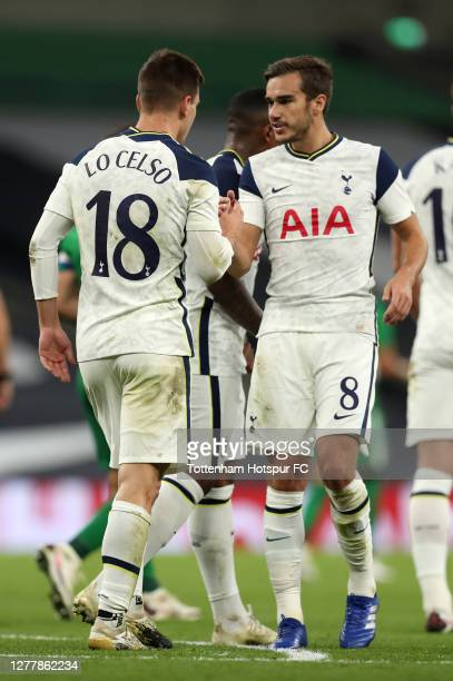 Giovani Lo Celso of Tottenham Hotspur celebrates with Harry Winks after scoring his team's fourth goal during the UEFA Europa League playoff match...