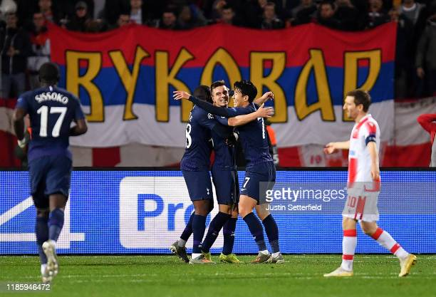 Giovani Lo Celso of Tottenham Hotspur celebrates with Heung-Min Son and Tanguy Ndombele after scoring his team's first goal during the UEFA Champions...