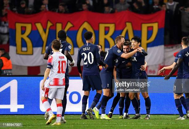 Giovani Lo Celso of Tottenham Hotspur celebrates with HeungMin Son Harry Kane and teammates after scoring his team's first goal during the UEFA...