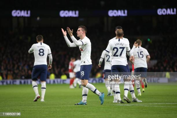 Giovani Lo Celso of Tottenham Hotspur celebrates with his teammates after scoring his sides first goal during the FA Cup Third Round Replay match...