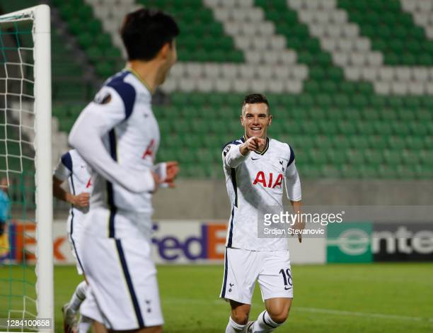 Giovani Lo Celso of Tottenham Hotspur celebrates with Son Heung-Min of Tottenham Hotspur after he scores his sides third goal during the UEFA Europa...