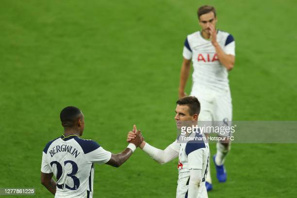 Giovani Lo Celso of Tottenham Hotspur celebrates with Steven Bergwijn after scoring his team's third goal during the UEFA Europa League playoff match...