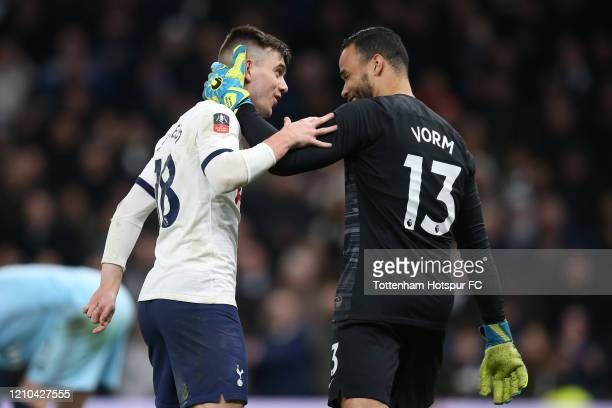 Giovani Lo Celso of Tottenham Hotspur celebrates with teammate Michel Vorm of Tottenham Hotspur after scoring a penalty in the penalty shootout...