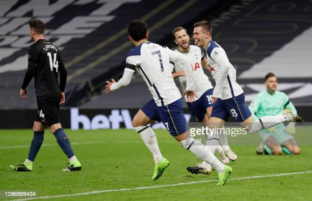 Giovani Lo Celso of Tottenham Hotspur celebrates with teammate Heung-Min Son after scoring his team's second goal during the Premier League match...