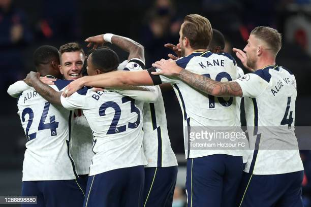 Giovani Lo Celso of Tottenham Hotspur celebrates with teammates after scoring his team's second goal during the Premier League match between...