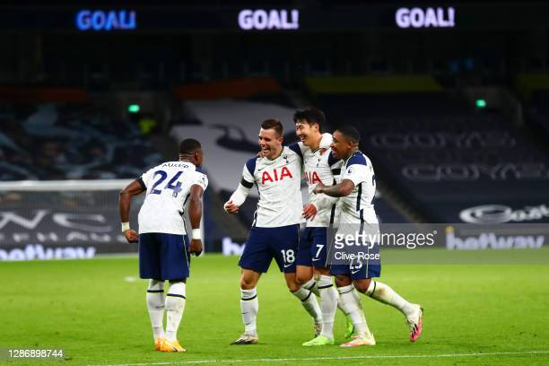 Giovani Lo Celso of Tottenham Hotspur celebrates with teammates Serge Aurier, Heung-Min Son, and Steven Bergwijn of Tottenham Hotspur after scoring...