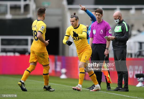 Giovani Lo Celso of Tottenham Hotspur is replaced by teammate Gareth Bale during the Premier League match between Newcastle United and Tottenham...
