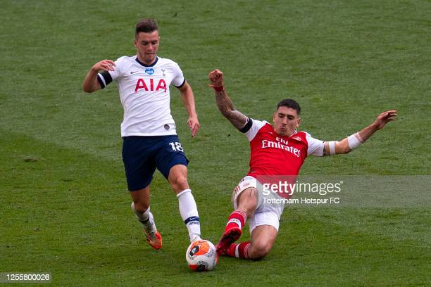 Giovani Lo Celso of Tottenham Hotspur is tackled by Hector Bellerin of Arsenal during the Premier League match between Tottenham Hotspur and Arsenal...