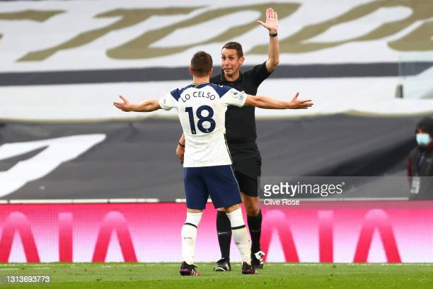 Giovani Lo Celso of Tottenham Hotspur reacts as Referee David Coote rules out a goal scored by Son Heung-Min of Tottenham Hotspur for offside after a...