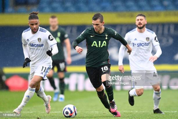 Giovani Lo Celso of Tottenham Hotspur runs with the ball whilst under pressure from Tyler Roberts of Leeds United during the Premier League match...