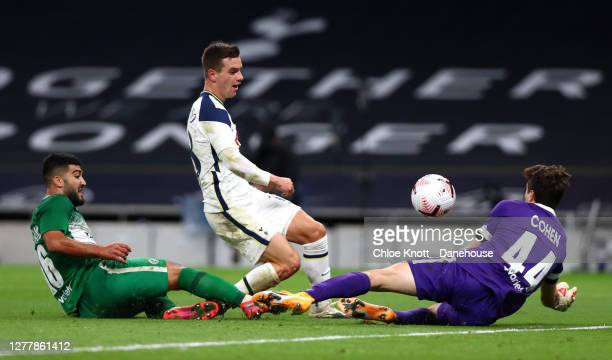 Giovani Lo Celso of Tottenham Hotspur scores his teams fourth goal during the UEFA Europa League playoff match between Tottenham Hotspur and Maccabi...
