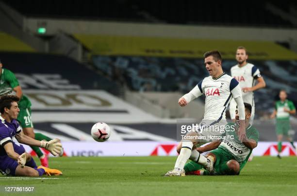 Giovani Lo Celso of Tottenham Hotspur scores his team's fourth goal during the UEFA Europa League playoff match between Tottenham Hotspur and Maccabi...