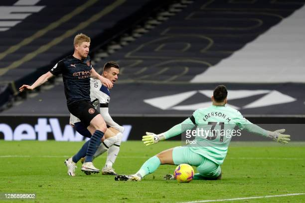 Giovani Lo Celso of Tottenham Hotspur scores his team's second goal past Ederson of Manchester City during the Premier League match between Tottenham...