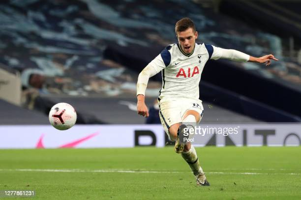 Giovani Lo Celso of Tottenham Hotspur scores his team's third goal during the UEFA Europa League playoff match between Tottenham Hotspur and Maccabi...