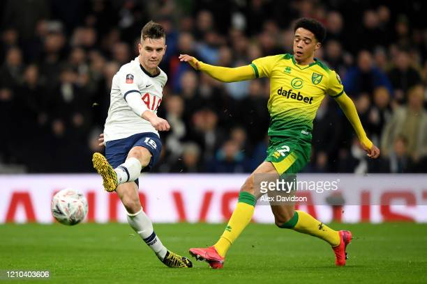 Giovani Lo Celso of Tottenham Hotspur shoots at goal with pressure from Jamal Lewis of Norwich City during the FA Cup Fifth Round match between...