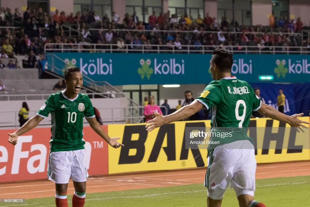 Giovanid Dos Santos and Raul Jimenez of Mexico celebrate their team's first goal during the match between Costa Rica and Mexico as part of the FIFA 2018 World Cup Qualifiers at Nacional de Costa Rica Stadium on September 05, 2017 in San Jose, Costa Rica.