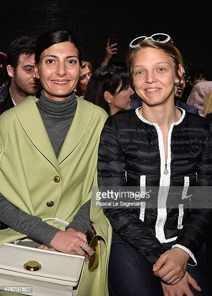 Giovanna Battaglia and Arianna Fontana attend the Moncler Gamme Rouge show as part of the Paris Fashion Week Womenswear Fall/Winter 20142015 on March...