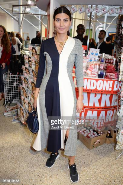 Giovanna Battaglia attends Hello Magazine's 30th anniversary party at Dover Street Market on May 9 2018 in London England