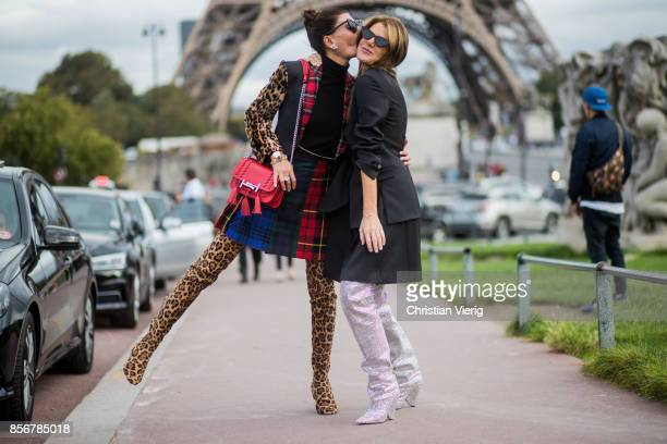 Giovanna Battaglia Engelbert and Anna dello Russo wearing YSL glitter boots seen outside Hermes during Paris Fashion Week Spring/Summer 2018 on...