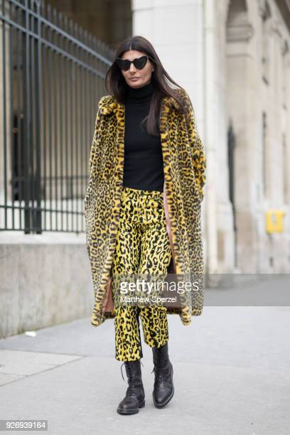 Giovanna Battaglia Engelbert is seen on the street attending Noir Kei Ninomiya during Paris Women's Fashion Week A/W 2018 wearing a yellow animal...