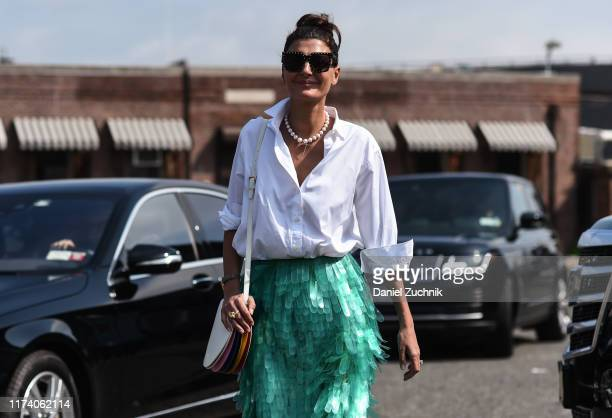 Giovanna Battaglia Engelbert is seen wearing a white top green plastic skirt and white bag outside the Michael Kors show during New York Fashion Week...