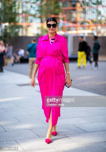 Giovanna Battaglia Engelbert wearing pink dress is seen outside Christopher Kane during London Fashion Week September 2018 on September 17, 2018 in...