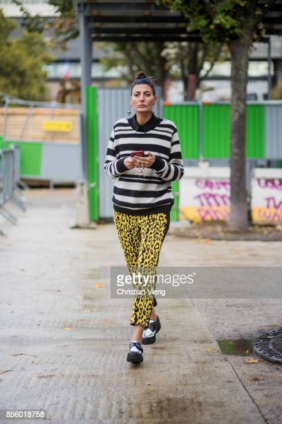 Giovanna Battaglia Engelbert wearing striped knit yellow pants with print is seen outside Haider Ackermann during Paris Fashion Week Spring/Summer...