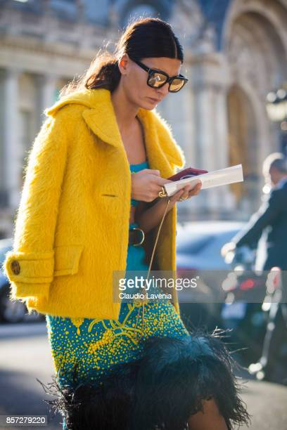 Giovanna Battaglia Engelbert wearing yellow jacket cropped top and a skirt is seen before the Chanel show during Paris Fashion Week Womenswear SS18...