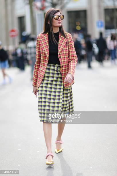Giovanna Battaglia Engelbert wears a blazer jacket a skirt a black top and heels outside the Miu Miu show during Paris Fashion Week Womenswear...