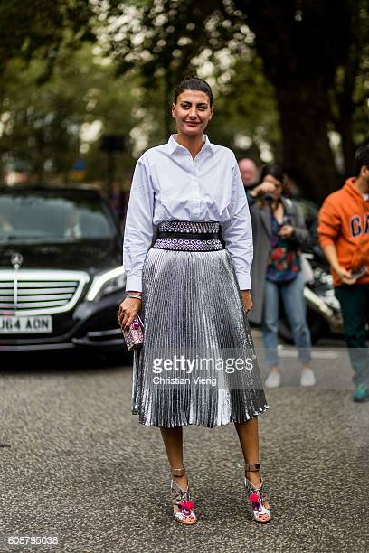 Giovanna Battaglia Engelhart wearing a metallic silver skirt white button shirt outside Christopher Kane during London Fashion Week Spring/Summer...