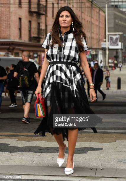 Giovanna Battaglia is seen wearing a Sacai dress with a Sara Battaglia bag outside the Michael Kors show during New York Fashion Week: Women's S/S...