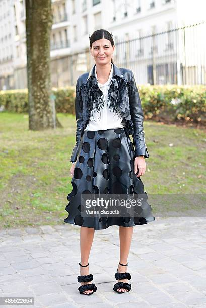 Giovanna Battaglia poses wearing Comme de Garcons Noir jacket and skirt on Day 5 of Paris Fashion Week Womenswear FW15 on March 7 2015 in Paris France
