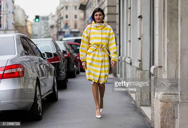Giovanna Battaglia wearing a Max Mara yellow white stripped coat seen outside Max Mara during Milan Fashion Week Fall/Winter 2016/17 on February 25...