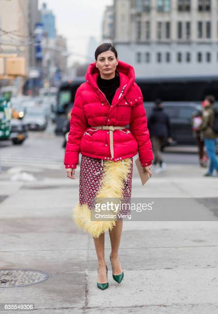 Giovanna Battaglia wearing a red down feather jacket outside Michael Kors on February 15 2017 in New York City