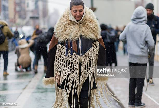 Giovanna Battaglia wearing a Sacai coat with fur and fringes seen outside Jeremy Scott during New York Fashion Week Women's Fall/Winter 2016 on...