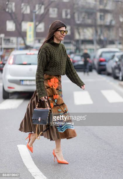 Giovanna Battaglia wearing an olive knit and Fendi skirt outside Fendi during Milan Fashion Week Fall/Winter 2017/18 on February 23, 2017 in Milan,...